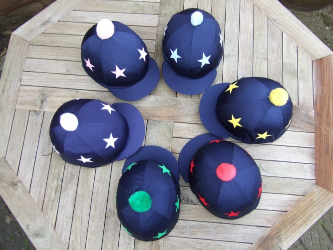Lycra hat covers with pom