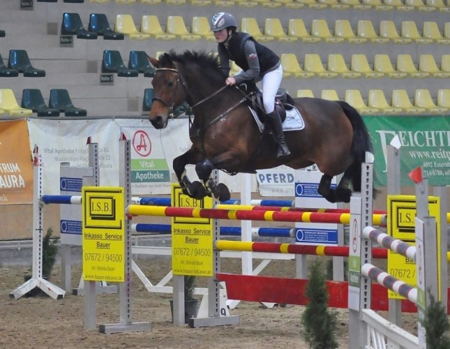 Benedetta Manfredi from Austria showjumping in her Helite Air Shell Gilet.