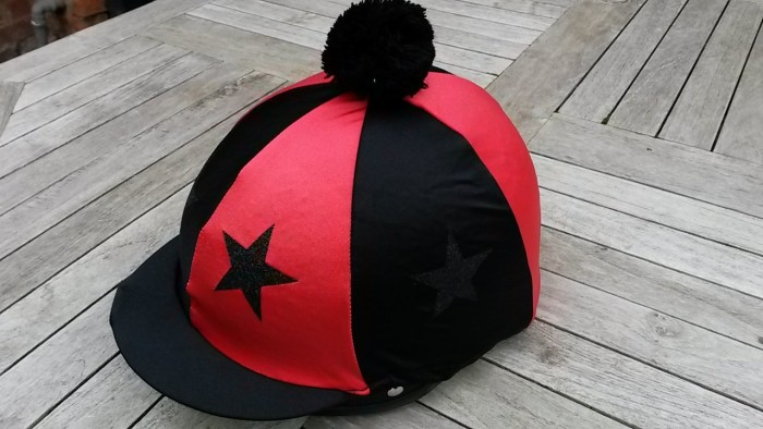 Standard Lycra Black and Red Segments with black glitter stars and pom.
