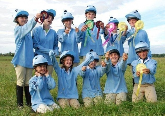 The Morpeth Hunt Pony Club Team in their Treehouse printed Rugby shirts and lycra caps.