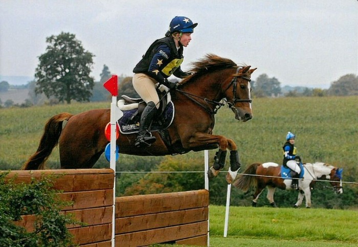 Abbey Rimmer in her bespoke xc colours with company logo Rostons on cap and shirt.