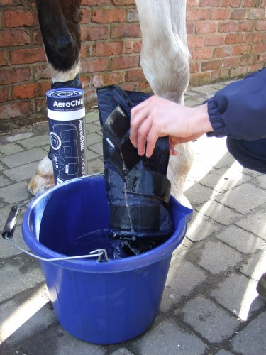Aerochill Boots being applied after quick soak in a bucket of water