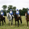 The Burghley Pony Club Team in royal blue rugby shirts with printing & stars hat silks.