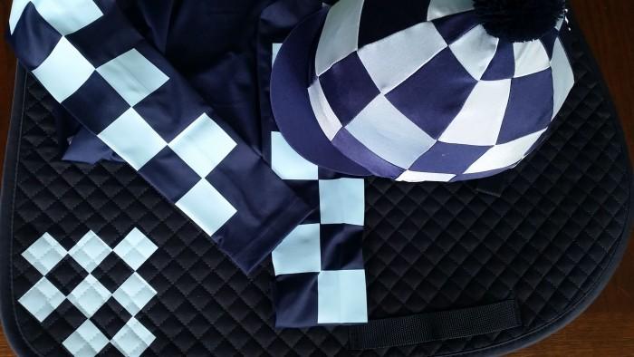 Checks set, lycra cap, base layer and saddlecloth with checks