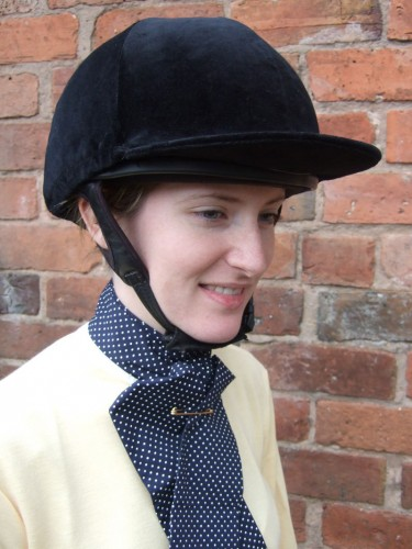 A Cotton Stock in dark blue and white spots worn with a ladies yellow stock shirt and velvet hat cover.
