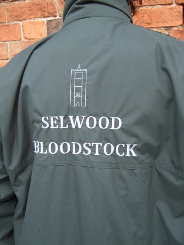 Dark green fleece lined jacket with embroidery.
