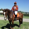 Sarah Paton in her orange and purple cotton drill shirt, saddlecloth and  RS2010.