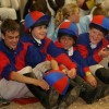 The North Shropshire Pony Club Tetrathlon team in their winning colours. Their colours are the cotton drill shirts in red and royal blue quartered with matching lycra hat covers