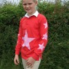 Red rugby shirt with pink stars.