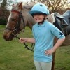 Jane in a light blue polo shirt with dark blue star design and matching lycra hat cover.