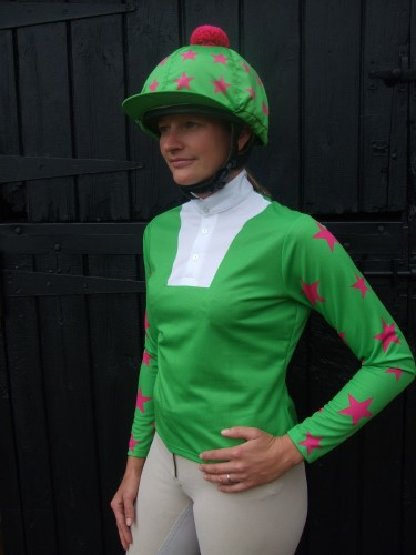 Light green ladies event shirt with cerise stars on sleeves, light green with cerise multi stars cap and pom.