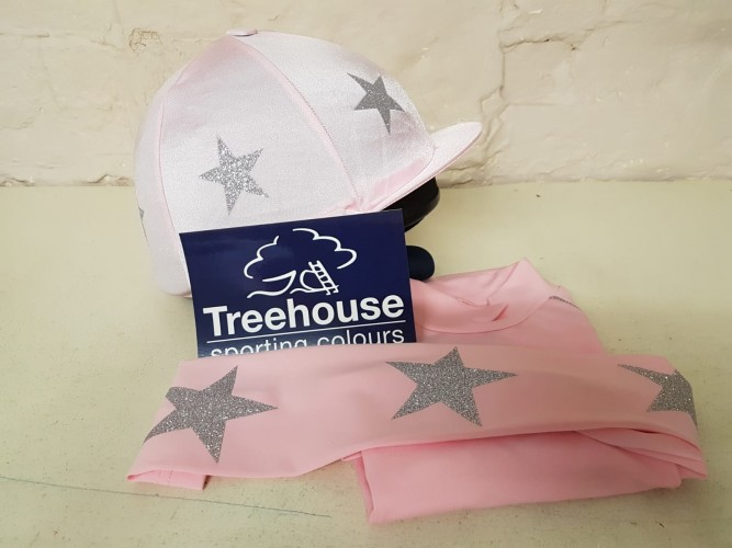 Light pink with silver glitter stars and cap.
