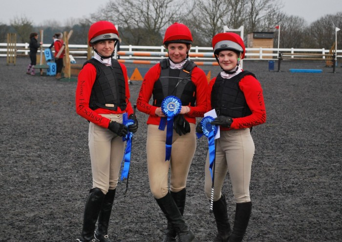 New Hall School Riding Team in their lycra printed hat covers and ladies long sleeve teeshirts.
