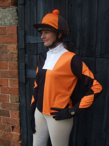 Orange and black halved event shirt, with 3 diamonds on the sleeves and a quartered silk cap with pom.
