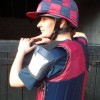 Sophie Talbot in a maroon and dark blue Racesafe with shoulder pads and checked silk cap