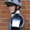 Sophie Talbot in a dark grey body protector with black shoulder pads