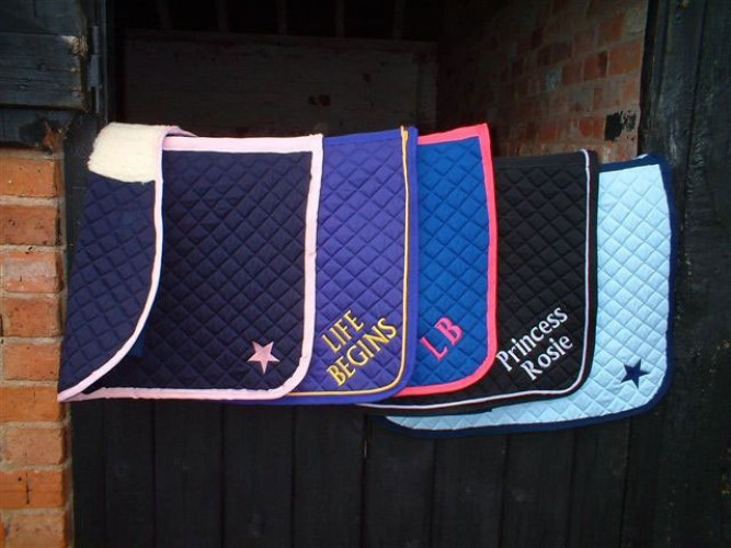 Examples of saddlecloths with plain lettering