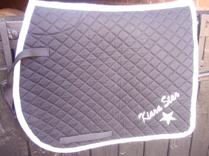A saddlecloth with script lettering