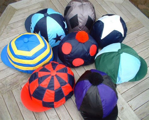 Clockwise from top: Dark grey with black diamonds, Dark blue with white star, Dark green and light blue quartered, Black and purple segments, Red and dark blue check, Royal blue and yellow hoops, Dark blue and light blue alternating segments and stars