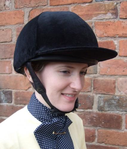 Annabell in a black velvet riding hat cover